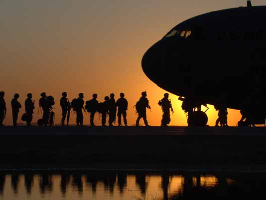 Soldiers boarding a C130